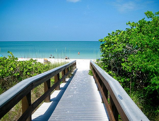 A Walkway Leading To Barefoot Beach In Naples Florida