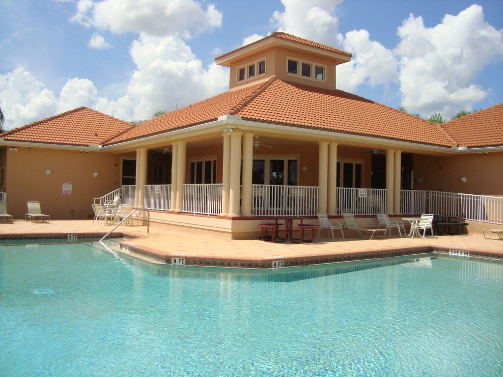 Pool and clubhouse at PebbleBrooke Lakes in Naples, Florida.