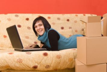 A homeowner check possible mortgage re-financing options on her laptop.